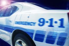 Police car at night moving high speed action photo. Background stock images