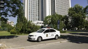 Police car parked in front of Ministry of Agriculture and Food Industry. Chisinau, Moldova - Circa 2018: Police car parked in front of Ministry of Agriculture stock video footage