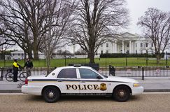 A police car parked in front of the White House in Washington DC Royalty Free Stock Photo