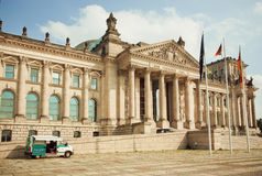 Police car parked past historical Reichstag building - German parliament Stock Photo