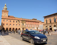 Police car in Piazza Maggiore of Bologna with tourists Royalty Free Stock Photo