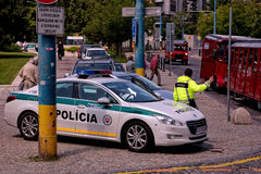 Police car with policeman on the street in Bratislava, in Slovakia Stock Images