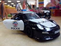 Police car. Porshe car toy Royalty Free Stock Image