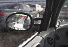 Police car in rearview mirror Stock Images