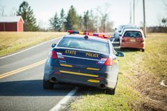 Police car on road with flash lights and siren. At day royalty free stock photo