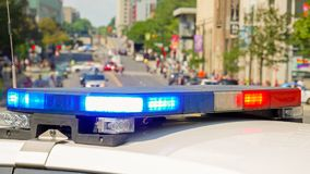 A police car rushes to the emergency call with lights turned on.  royalty free stock photos