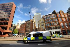 Police rushing to an incident on the streets of London, England Royalty Free Stock Photos