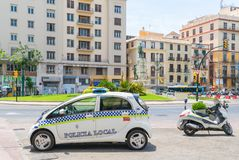 Police car and scooter parked on the Plaza de La Marina stock photography