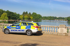 Police car, Serpentine Lake, Hyde Park in London Royalty Free Stock Photography
