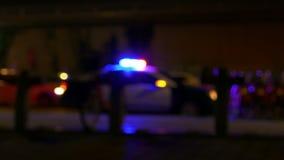 Police car siren flashing, defocused stock video footage