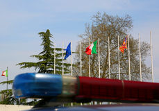 Police car sirens with blurry effect and European and Italian fl Royalty Free Stock Image