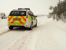 Police Car in the Snow in Scotland. Northern Constabulary/Police Scotland Ford Focus Police car on patrol in winter conditions, Essich Road, above Inverness Royalty Free Stock Photo