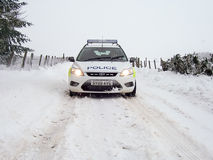 Police Car in the Snow in Scotland. Northern Constabulary/Police Scotland Ford Focus Police car on patrol in winter conditions, Essich Road, above Inverness Royalty Free Stock Image