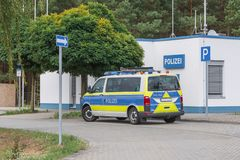 Police car at a police station on the motorway. A car of the car police is standing in front of the guard of the highway police royalty free stock photos