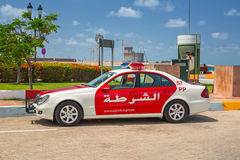 Police car on the street of Abu Dhabi Stock Photography