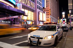 Police car on Times Square New York at night. Police car is standing by on Times Square New York in the evening after the attempted car bomb royalty free stock image