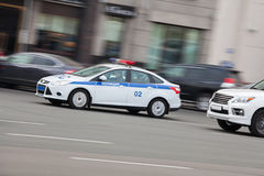 Russian police car. A police car fast rides on road royalty free stock photography