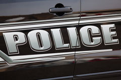 Police Car. Up close view of lettering on the side of the car Stock Photography