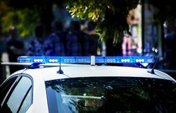 Police car with blue lights. The police car is white and gray with blue lights. The background is blurred royalty free stock photography