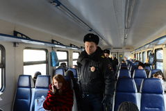 Police in the carriage commuter trains. Royalty Free Stock Photography