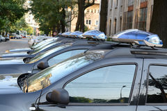 Police Cars. In A Row Stock Images