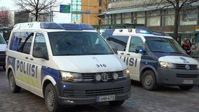 Police cars with flashing lights moving through the center of city stock video footage