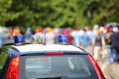 Police cars flashing sirens in the city Royalty Free Stock Image