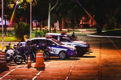 Police cars of Guarda Municipal at and event in Campo Grande MS,. Campo Grande, Brazil - April 14, 2018: Local police cars Guarda Municipal at night on an event Royalty Free Stock Image