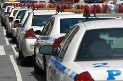 Police Cars in NYC. Police cars parked in a row along a street in New York City Stock Images
