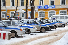 Police cars are parked near a local police department Stock Image