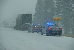 Police cars stop to assist Stock Photo