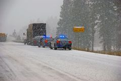 Police cars stop to assist Stock Photography