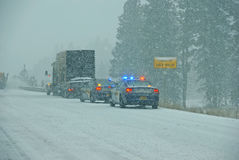 Police cars stop to assist Royalty Free Stock Image