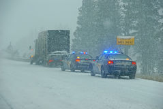 Police cars stop to assist Royalty Free Stock Images