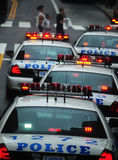 Police cars stoped. Police cars with lights flashing waiting to turn at a stop sign in new york city on a warm day in june 2008 Royalty Free Stock Photo