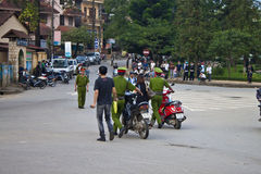 Police catched motorbike riders. SAPA, VIETNAM - AUGUST 11: Police catched motorbike riders because of not using helmet on August 11, 2012 in Sapa, Vietnam. From Royalty Free Stock Photos