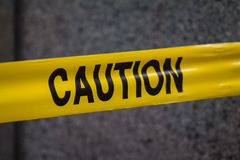Police caution sign tape in city. Close up stock photography