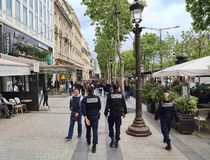 Police on the Champs-Elysees in Paris, France. Paris, France - May 13, 2018: Police officers patrol on the Avenue des Champs-Elysees in Paris, France on May 13 royalty free stock photo