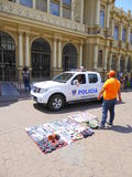 Street trader and police car. In San Jose, Costa Rica royalty free stock image