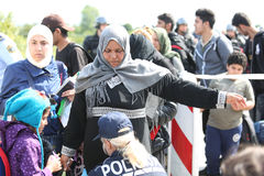 Police checking refugees Royalty Free Stock Photo