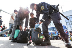 Police checking refugees on state border Stock Image