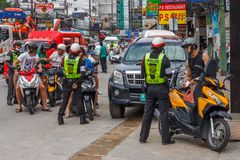 Police checking tourist driving licenses. Phuket, Thailand-6th January 2017: Police checking tourist driving licenses. Th police target foreigners and issue royalty free stock photos