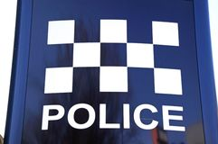 Police chequered sign. Stock Photography