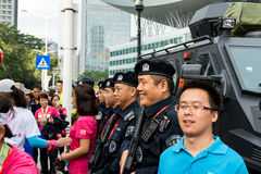 Police and citizens. Citizens are taking pictures with SWAP who are on duty with wepons on the day of Shenzhen Marathon 2015 Stock Photography