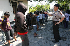 Police. In the city of Solo, Central Java, Indonesia arrested and detained 32 people on a city street drunks Stock Photo
