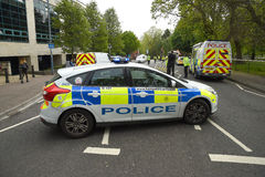 Police close a busy road at the scene of a traffic incident. Stock Images