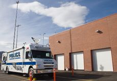 Police comm van 1. A police communications/mobile command post van, with antennas extended, next to the police station garage Royalty Free Stock Image