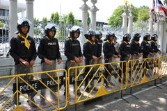 Police Commandos Stand Guard at Thai Parliament. Police commandos stand guard outside the Thai Parliament after the government invokes the Internal Security Act Stock Photo