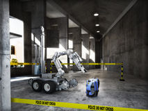 Police controlled bomb squad robot inspecting a suspicious backpack item inside a building interior Stock Images