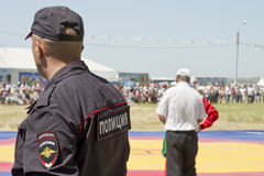Police in the cordon keeping order at a sports event Royalty Free Stock Images